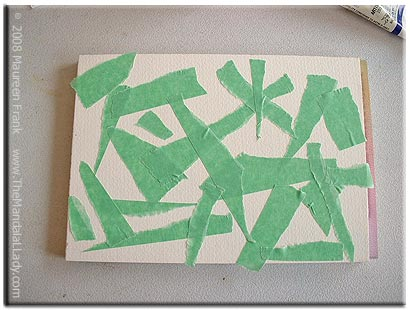 Put pieces of tape on the paper
